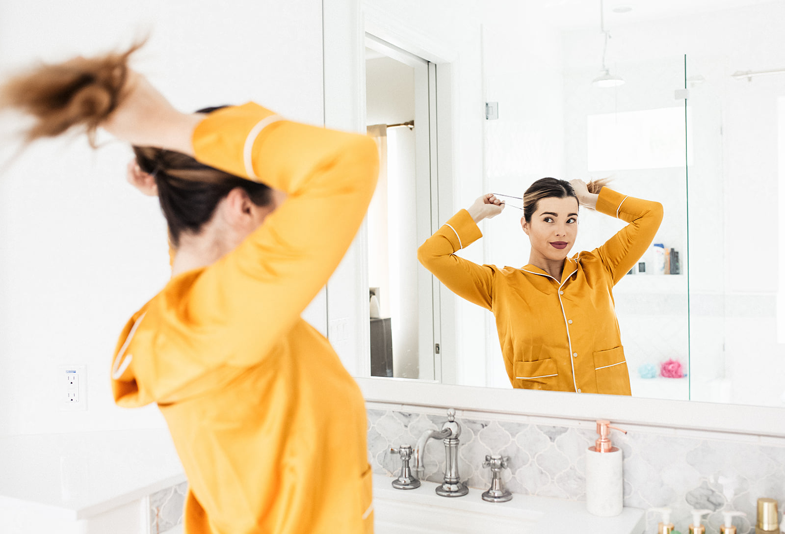 Pulling your hair back to get started on your morning skincare routine