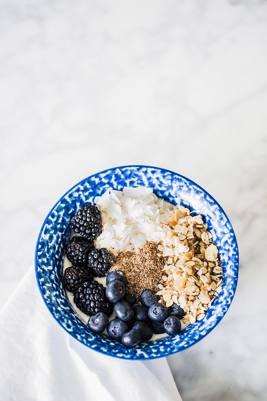 No Processed Sugar: Granola Bowl Recipe with Almond Milk, Coconut, Berries, seeds, & more!