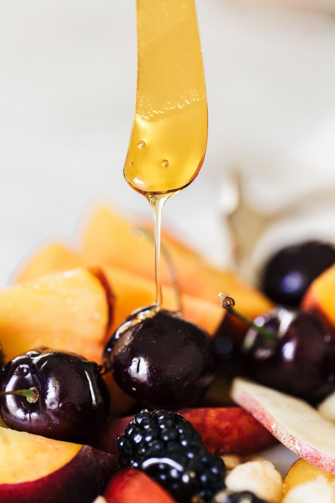 organic honey drizzle on fruit salad