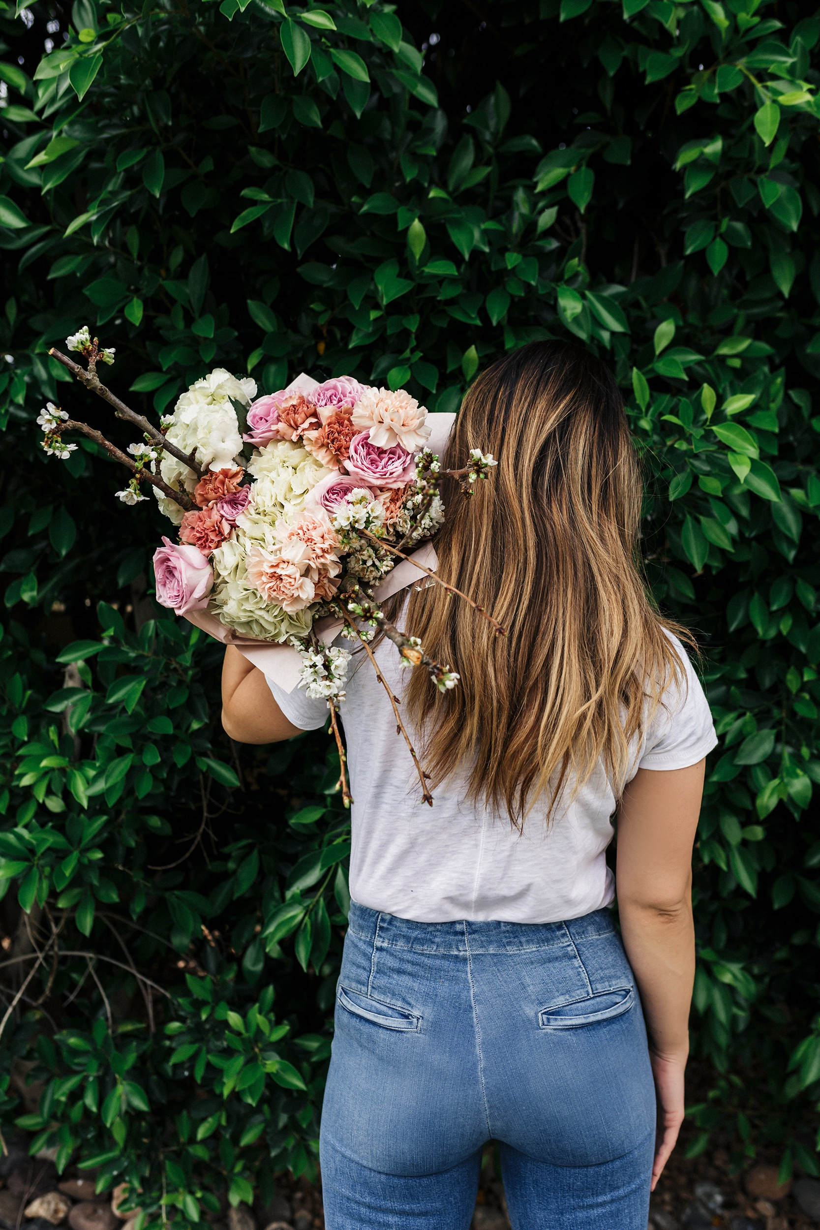 Flowers, white tee and jeans
