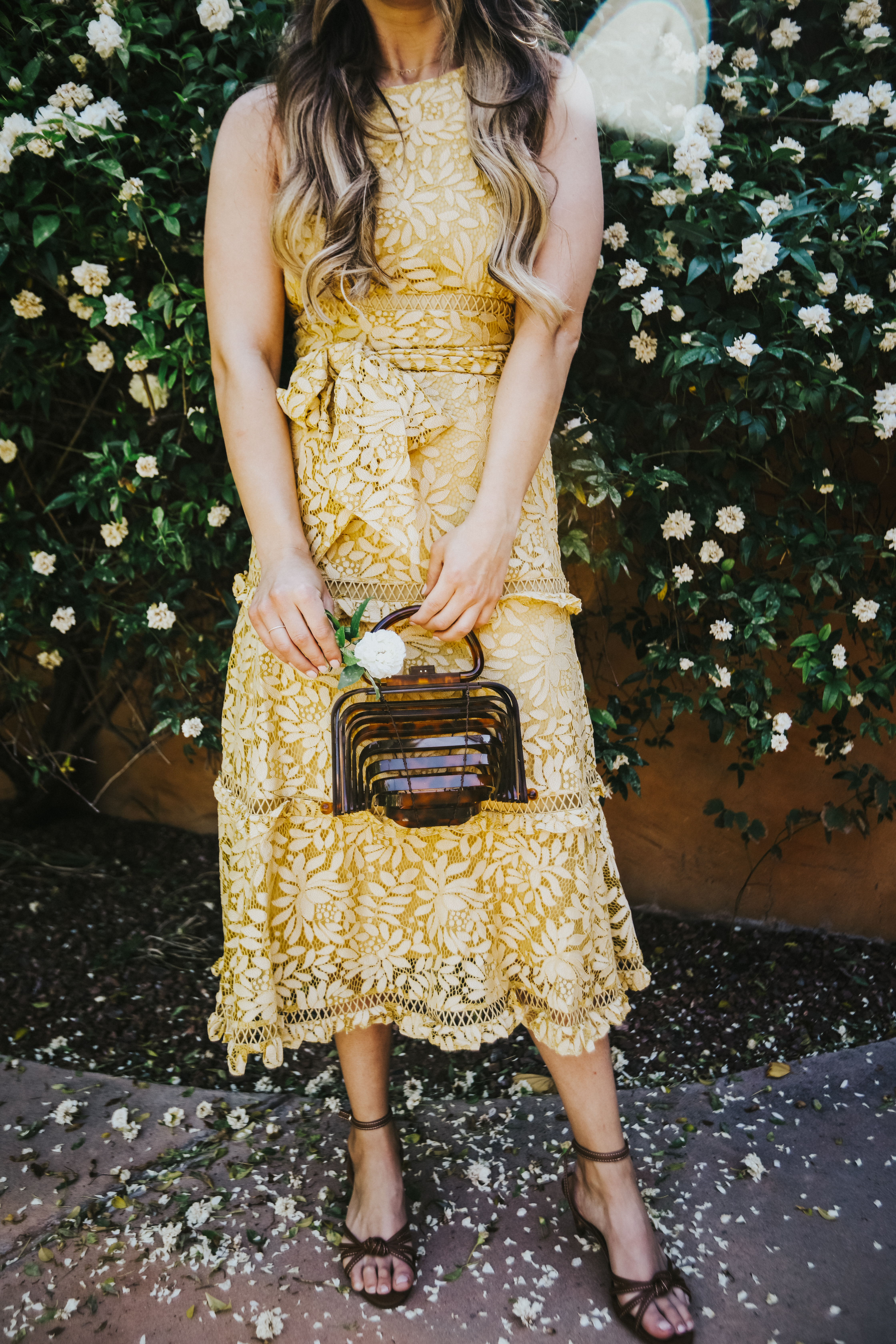 Becca Robson is wearing a preppy yellow lace dress