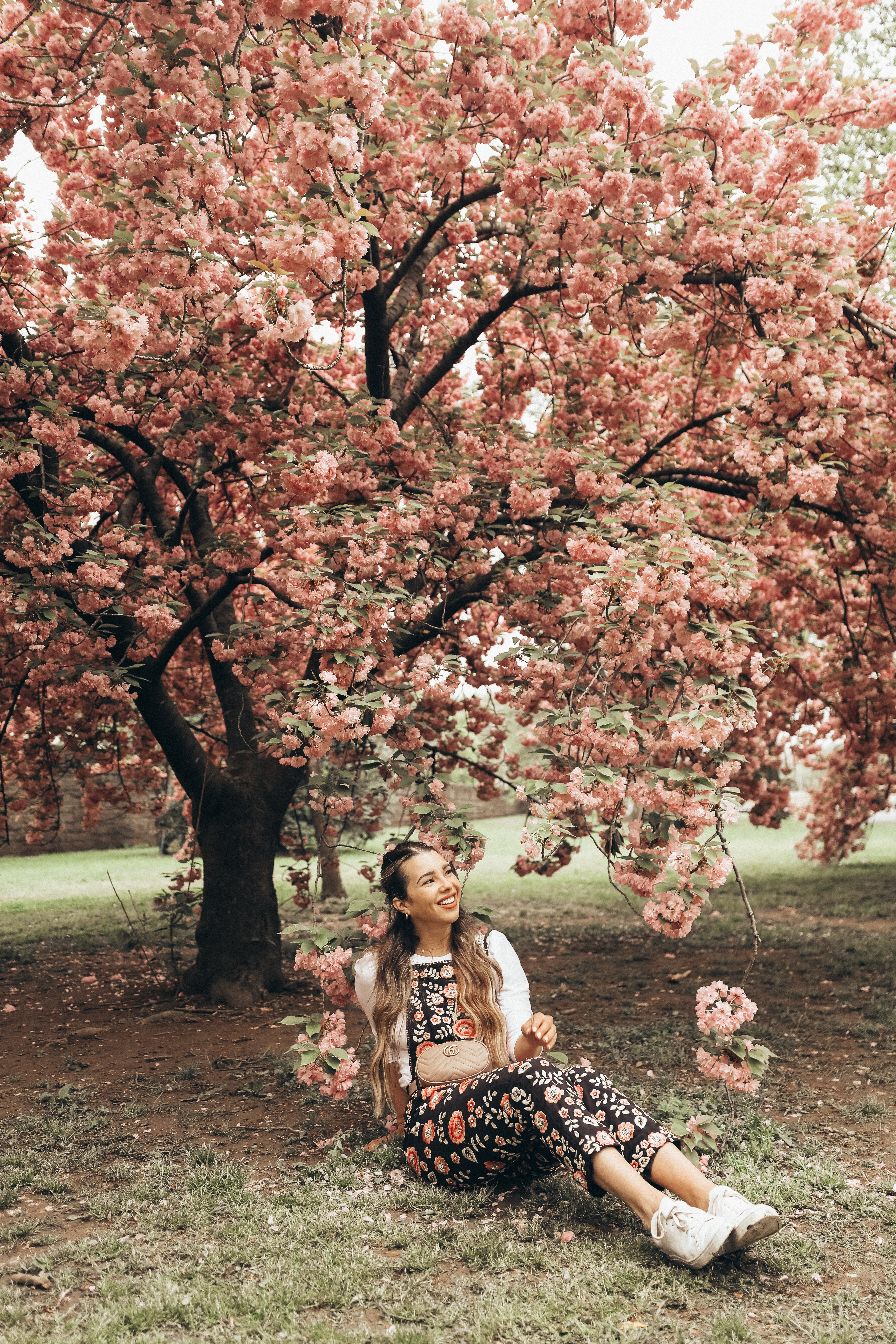 Becca Robson is under a cherry blossom tree