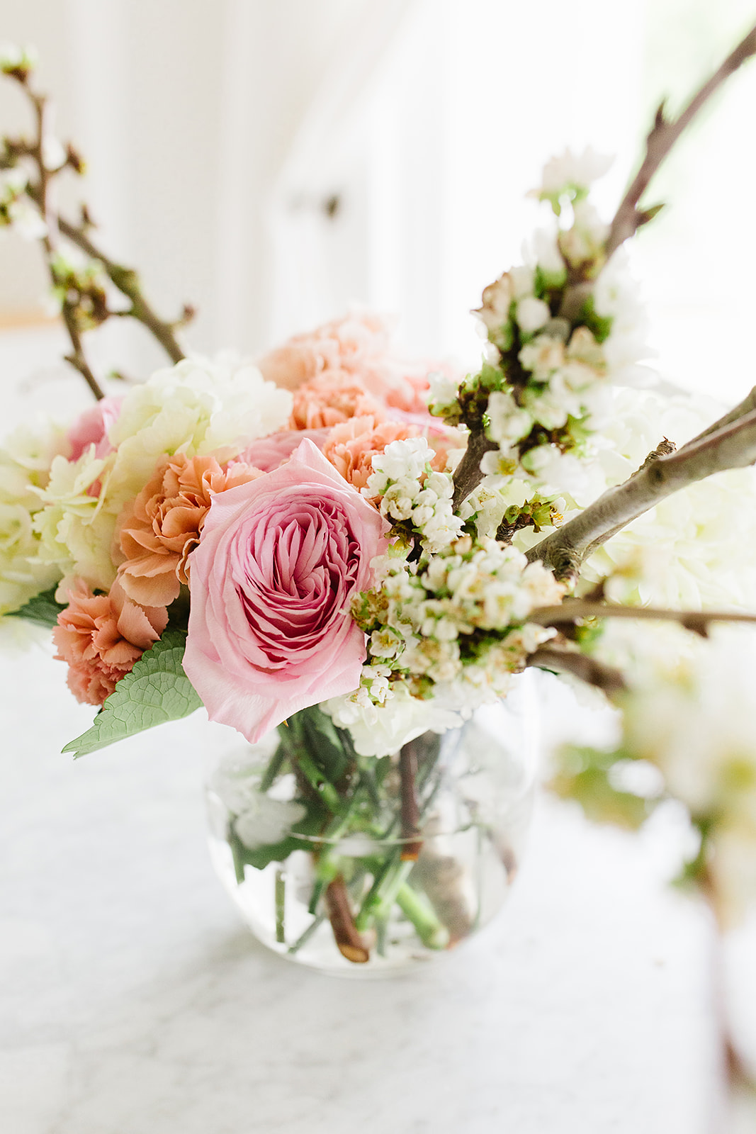 Florals used in these photos: cherry blossoms, hydrangea, carnations, garden roses